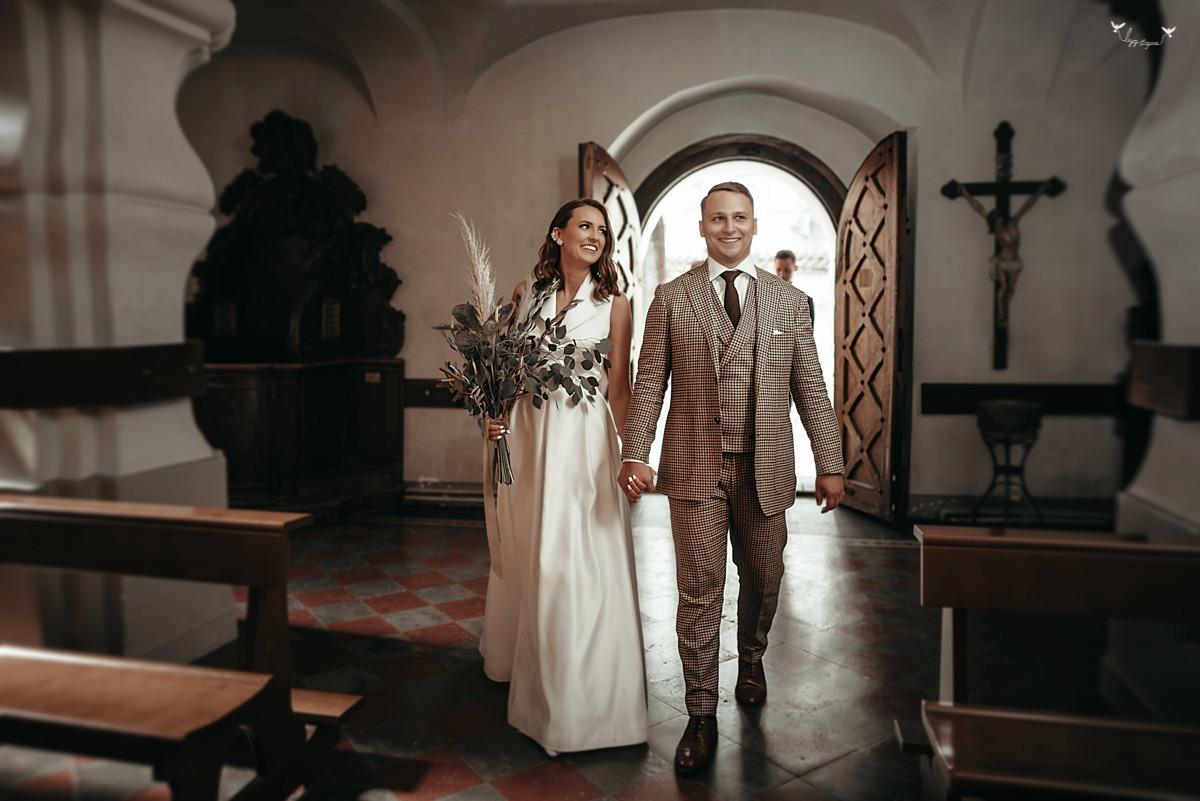 Vestuvių ceremonija Vilniaus Šv. Mikalojaus bažnyčioje